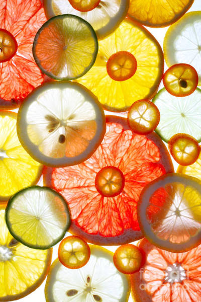 Wall Art - Photograph - Sliced Citrus Fruits Background by Gaak