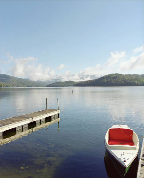 Jason Day Photograph - Small Boat Tied Up On Dock At Lake by Jason Todd