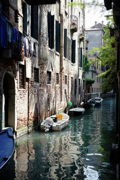Clothesline Photograph - Small Boats In Canal by Johner Images
