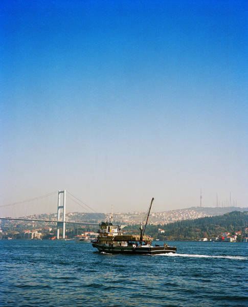 Wall Art - Photograph - Small Cargo Ship On The Bosphorus Strait by Andrew Rowat