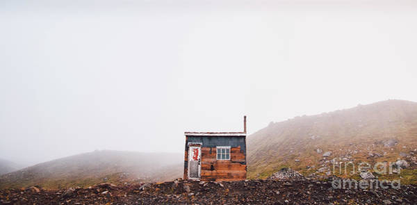 Photograph - Small Wooden Hut On Top Of A Mountain Surrounded By Fog In Winter To Seek Solitude. by Joaquin Corbalan
