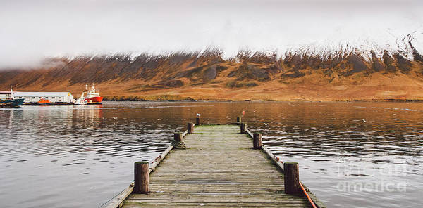 Photograph - Small Wooden Pier Centered On A Lake, Facing A Snowy Mountain. by Joaquin Corbalan