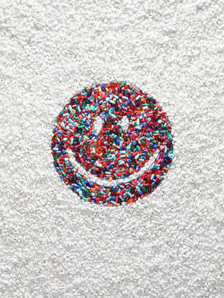 Capitalism Wall Art - Photograph - Smiley Face Of Pills by Dwight Eschliman