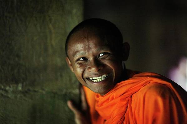 Toothy Smile Photograph - Smiling Buddhist Monk At Angkor Wat by Timothy Allen