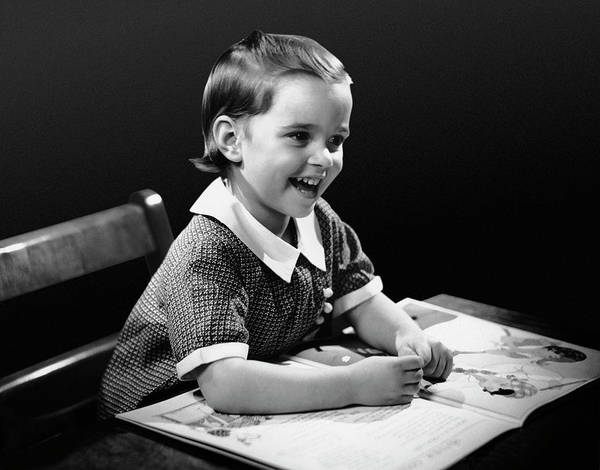 Playful Photograph - Smiling Young Girl Reading Book by George Marks
