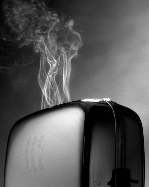 Shock Wall Art - Photograph - Smoke Coming Out Of A Toaster by John Manno