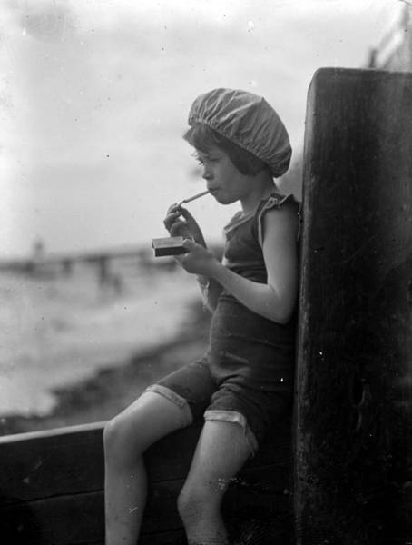 Forbidden Wall Art - Photograph - Smoking Child by General Photographic Agency