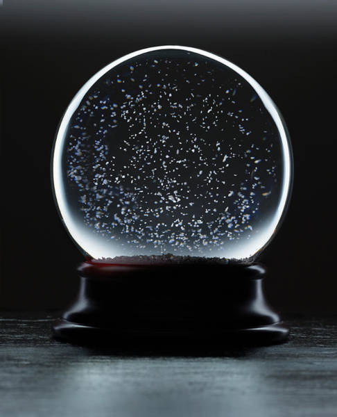 Black Background Photograph - Snow Falling In Darkly Lit Snowglobe by Steve Bronstein