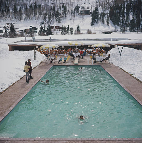 Group Of People Photograph - Snow Round The Pool by Slim Aarons