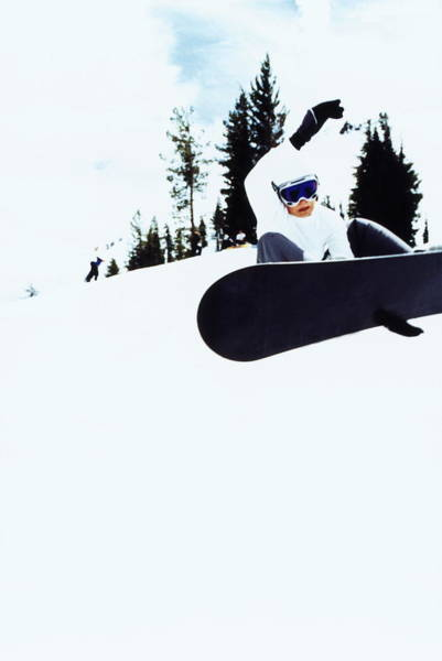 Photograph - Snowboarder Performing Stunt by Anne-marie Weber