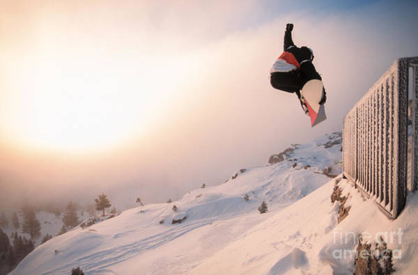 Wall Art - Photograph - Snowboarding Off A Cliff Off Piste On A by Donland