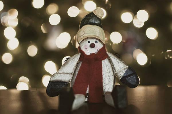 Photograph - Snowman Decor And Bokeh by Keith Smith