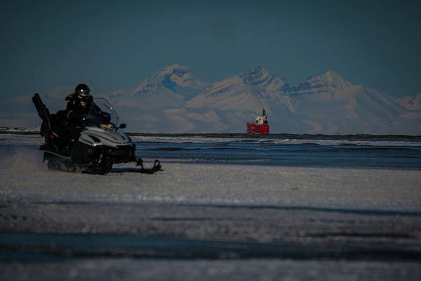 Photograph - Snowmobile On Frozen Fjord by Kai Mueller