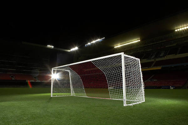 Team Sport Photograph - Soccer Goal In Empty Floodlit Stadium by Tay Rees