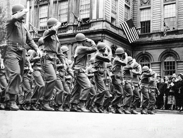 Wall Art - Photograph - Soldiers Of The 4th Division Salute As by New York Daily News Archive