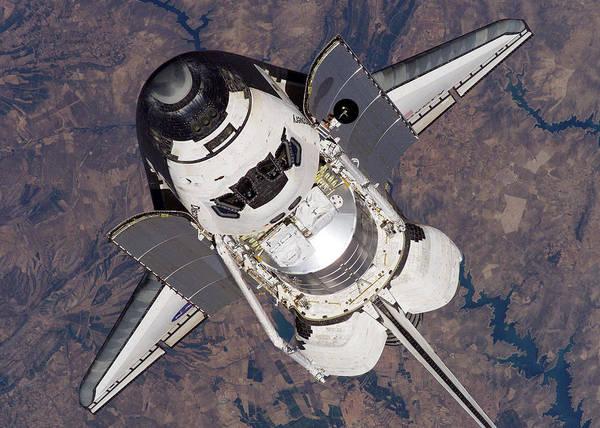 Wall Art - Digital Art - Space Shuttle Above Earth by Filip Hellman