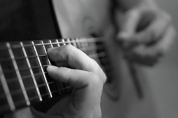 Spanish Guitar Wall Art - Photograph - Spanish Guitar With Film Grain by Elwisz