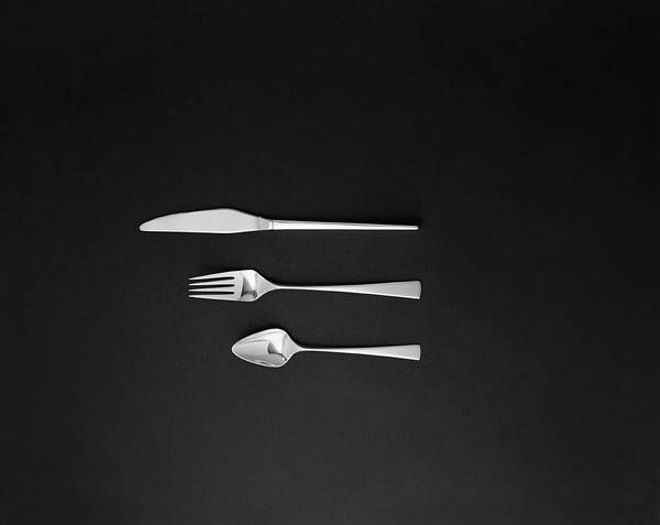 Photograph - Spoon, Fork And Butter Knife On Black by Tom Kelley Archive