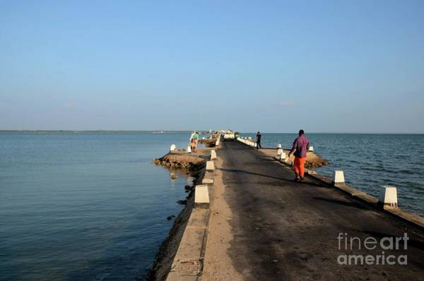 Photograph - Sri Lankans Walk On A Causeway Road Out Towards A Jetty In Water Jaffna Sri Lanka by Imran Ahmed