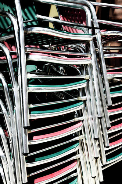 Wall Art - Photograph - Stack Of Chrome Chairs by Marilyn Hunt