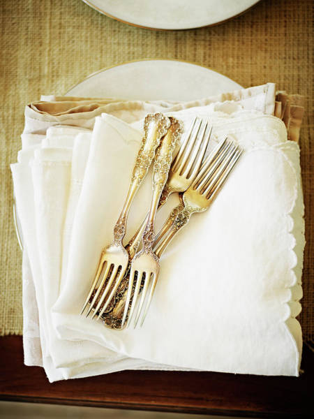 Wall Art - Photograph - Stack Of Silver Forks And Napkins by Thomas Barwick