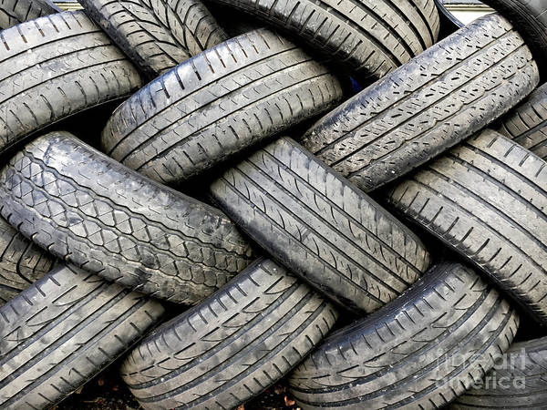 Wall Art - Photograph - Stacked Tyres by Tom Gowanlock