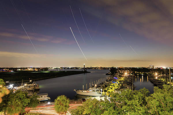 Wall Art - Photograph - Star Trails Above A Lake In Houston by Jeff Dai