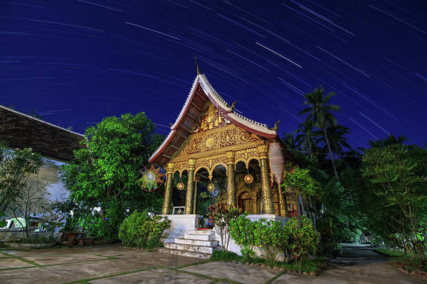Wall Art - Photograph - Star Trails Above A Temple In Luang by Jeff Dai