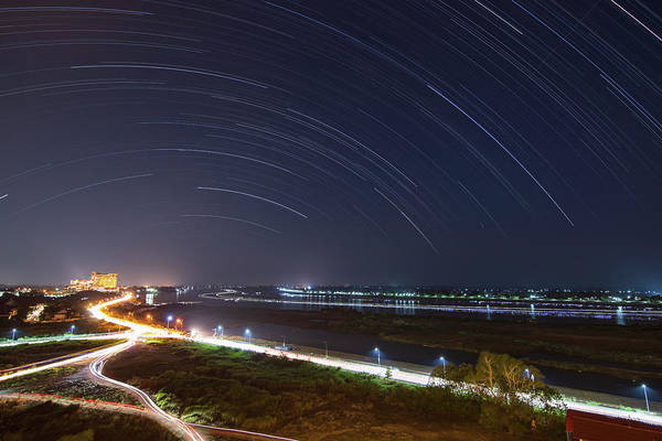 Wall Art - Photograph - Star Trails Above Phnom Penh by Jeff Dai