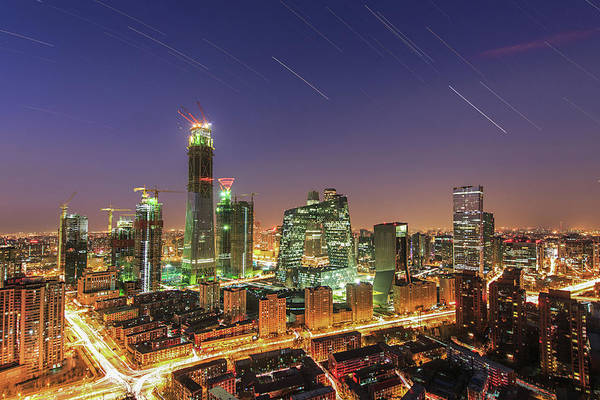 Wall Art - Photograph - Star Trails Above The Central Business by Jeff Dai
