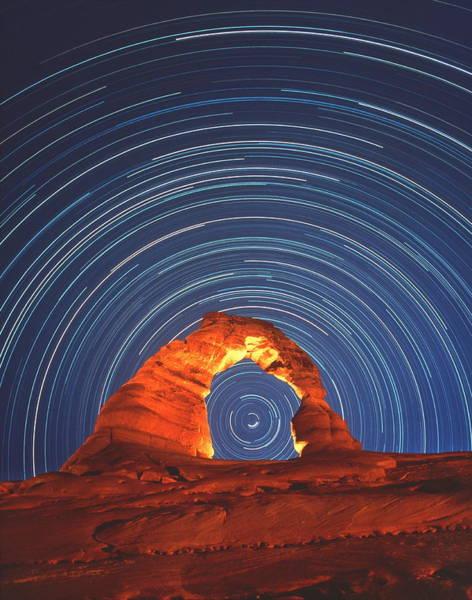 Natural Arch Photograph - Star Trails Seen Through A Natural Rock by David Nunuk