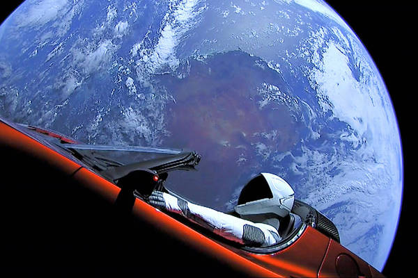 Photograph - Starman, Tesla And Earth Outer Space Image by Bill Swartwout Photography