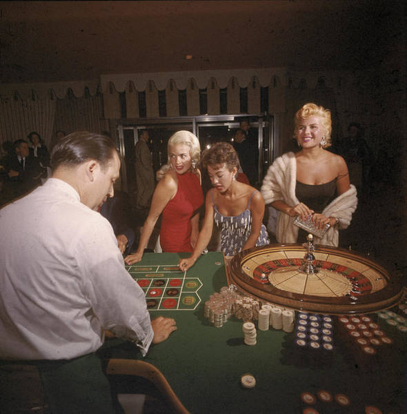 Sex Symbol Photograph - Stars At The Roulette Table by Loomis Dean