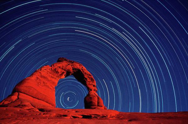 Natural Arch Photograph - Stars Trails & Delicate Arch by David Nunuk