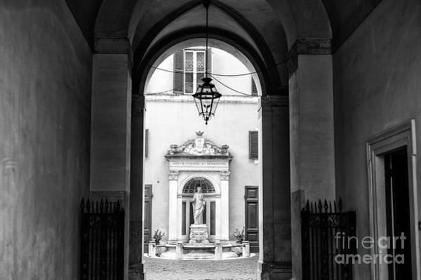Photograph - Statue Light At Palazzo Ferrajoli In Rome by John Rizzuto