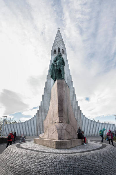 Wall Art - Photograph - Statue Of Explorer Leif Erikson And Hallgrimskirkja In Reykjavik by RicardMN Photography