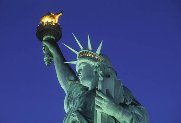Statue Photograph - Statue Of Liberty At Dusk by John Cardasis