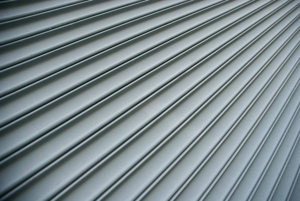 Photograph - Steel Shutter Lines Background Diagonal by Peskymonkey