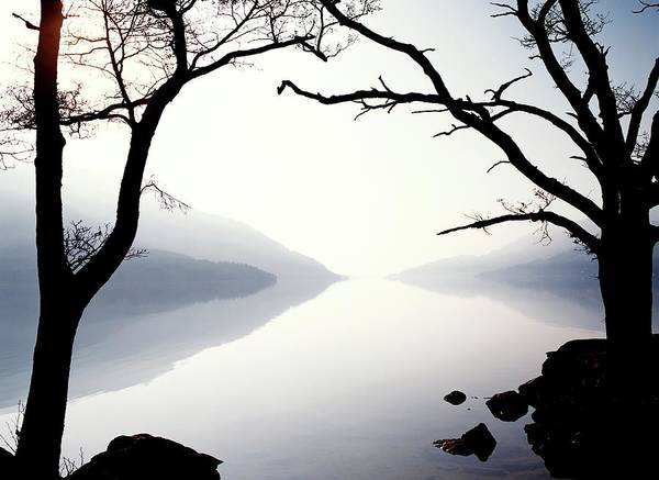 Northern Scotland Wall Art - Photograph - Still Blue Lake With Trees In Silhouette by Ian Cumming