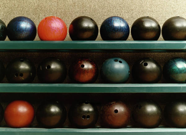 Ten Pin Bowling Wall Art - Photograph - Still Life Of Bowling Balls On A Shelf by Terry Vine