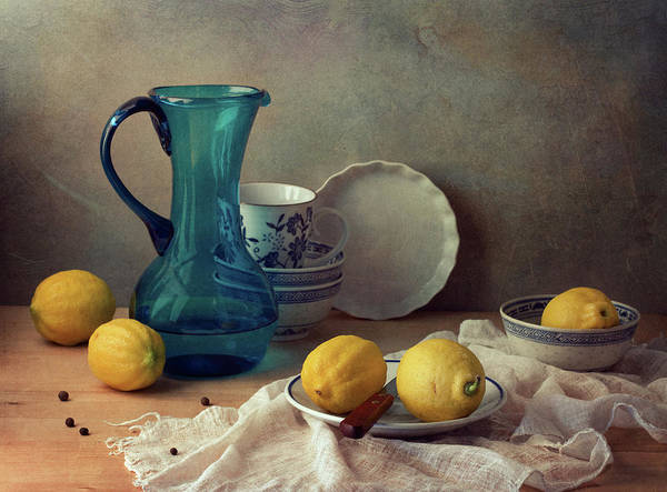 Healthy Eating Photograph - Still Life With Lemons And Blue Glass by Copyright Anna Nemoy(xaomena)