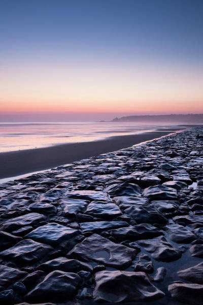 End Of Summer Photograph - Stone Sea Defence At St Ouens Beach On by David Clapp