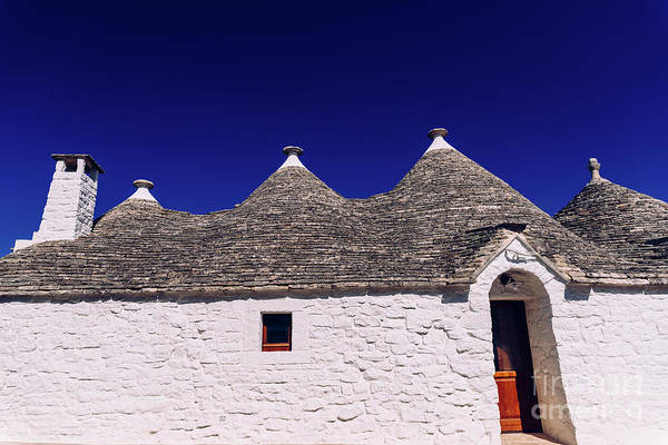 Photograph - Stone Tiles Cover The Roofs Of The Trulli In Alberobello, An Italian City To Visit On A Trip To Italy. by Joaquin Corbalan