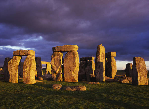 Endurance Wall Art - Photograph - Stonehenge With Dark Clouds, Wiltshire by Charles Bowman
