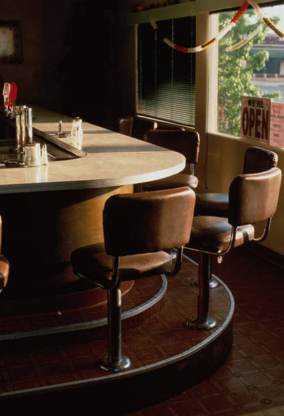 Bar Counter Photograph - Stools Along Bar Of Diner by David Zaitz