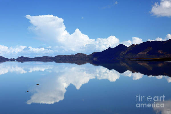 Photograph - Storm Cloud Rising Over Salar De Uyuni Bolivia by James Brunker