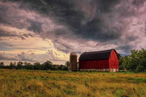 Photograph - Storming Over A Red Barn by Dale Kauzlaric
