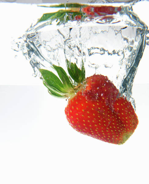 Underwater Photograph - Strawberry Dropping Underwater by Sami Sarkis