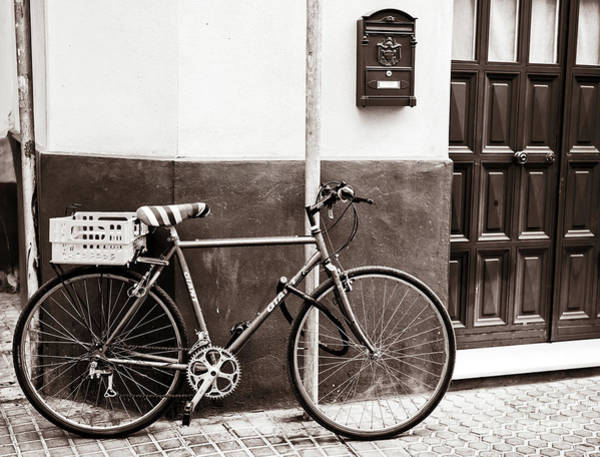Photograph - Street Bicycle In Seville by John Rizzuto