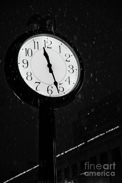 Photograph - Street Clock During A Snowfall, Time Passes. by Joaquin Corbalan